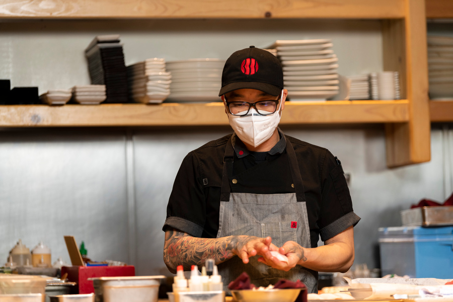 Chef Billy Ngo rolling sushi inside his restaurant Kru in Sacramento, CA